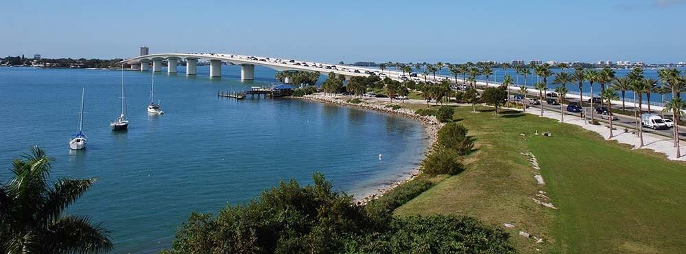 Driving a rental car over Blue Sky Bridge Sarasota, Florida